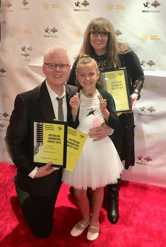 Roxanne celebrates her co-writing award for 1st Place in the songs For Children at the Australian Songwriters Association 2018 Awards night with co-writer Stephen Kiely, pictured here with the dynamic young performer Sky Clementine, who sang the winning song, Sometimes A Friend